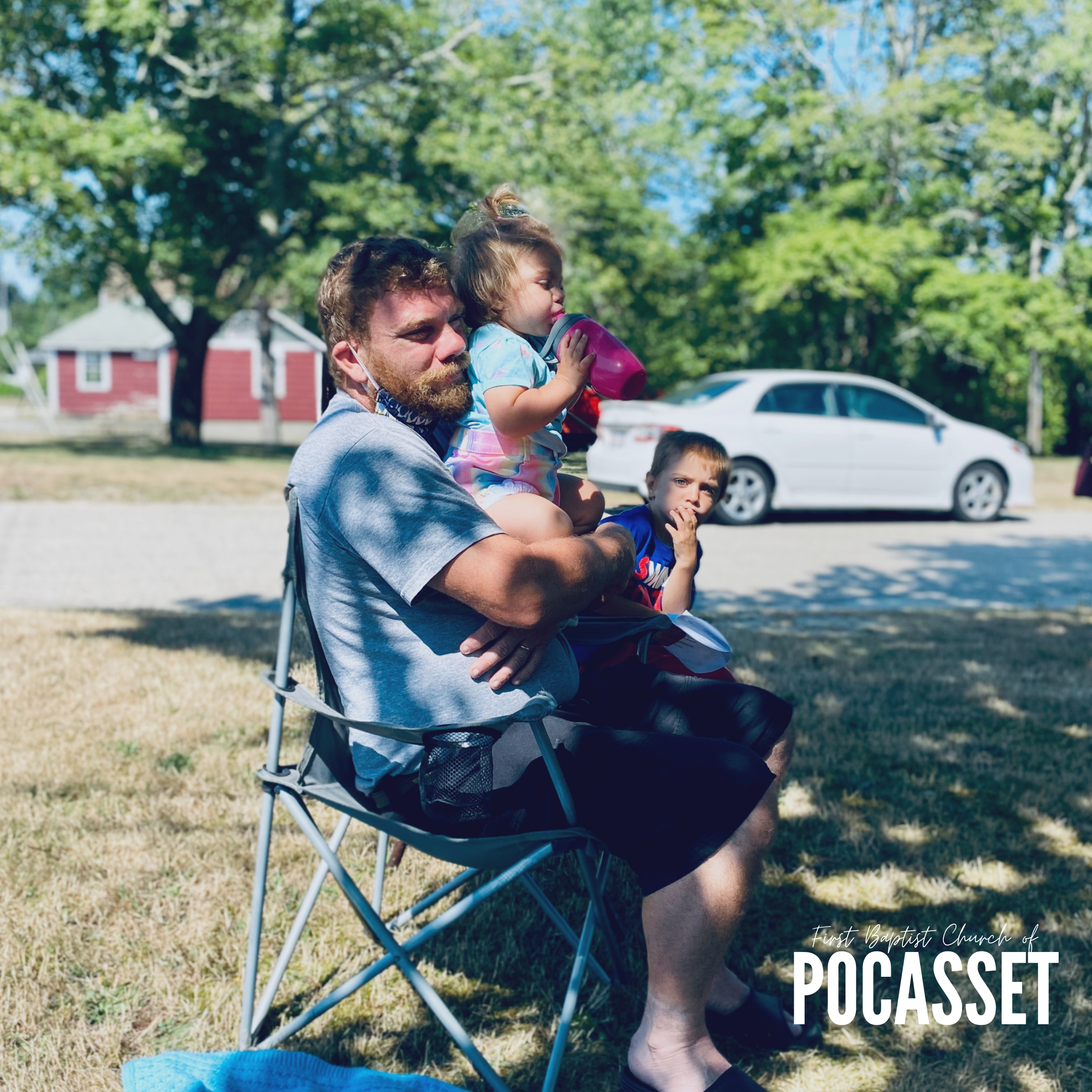 man with baby in lawnchair